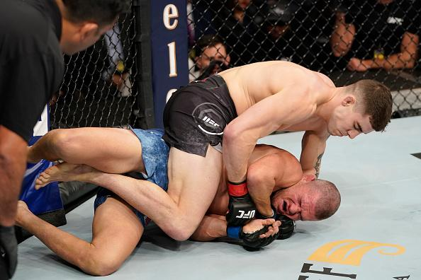 Joe Solecki (top) punches Matt Wiman in their lightweight bout during the UFC Fight Night event at Capital One Arena on December 07, 2019 in Washington, DC. (Photo by Jeff Bottari/Zuffa LLC)