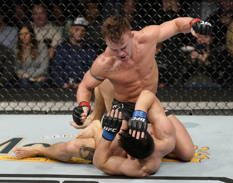 Cody Stamann (top) punches Song Yadong of China in their bantamweight bout during the UFC Fight Night event at Capital One Arena on December 07, 2019 in Washington, DC. (Photo by Jeff Bottari/Zuffa LLC via Getty Images)