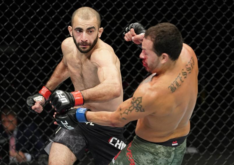 Giga Chikadze of Georgia punches Irwin Rivera of Mexico in their featherweight fight during the UFC Fight Night event at VyStar Veterans Memorial Arena on May 16, 2020 in Jacksonville, Florida. (Photo by Cooper Neill/Zuffa LLC via Getty Images)