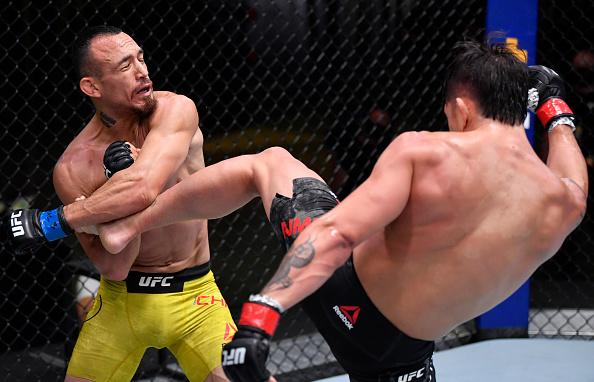 TJ Brown kicks Danny Chavez in their featherweight bout during the UFC 252 event at UFC APEX on August 15, 2020 in Las Vegas, Nevada. (Photo by Jeff Bottari/Zuffa LLC)