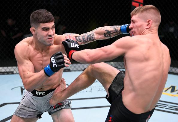 Joe Solecki punches Austin Hubbard in their lightweight fight during the UFC Fight Night event at UFC APEX on August 22, 2020 in Las Vegas, Nevada. (Photo by Chris Unger/Zuffa LLC)