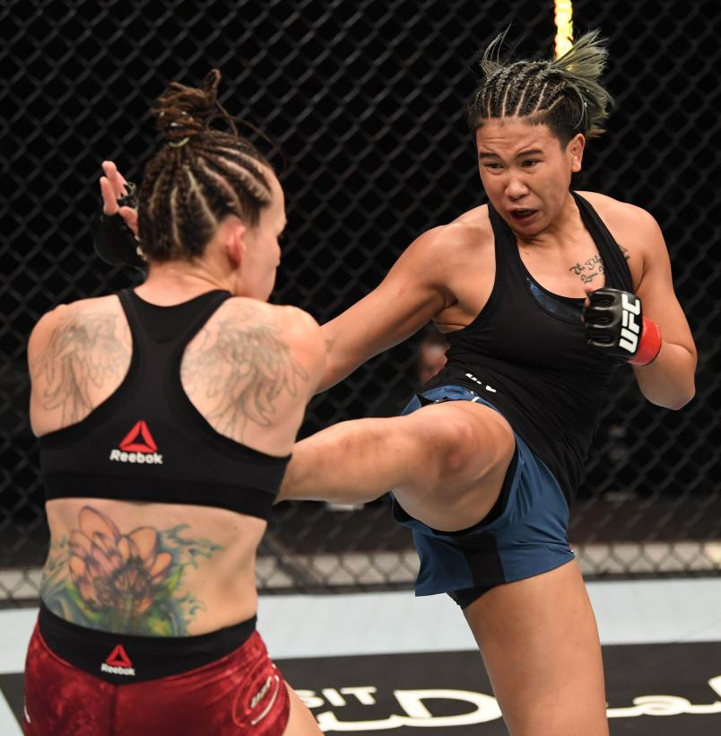 Loma Lookboonmee of Thailand kicks Jinh Yu Frey in their women's strawweight bout during the UFC Fight Night event inside Flash Forum on UFC Fight Island on October 04, 2020 in Abu Dhabi, United Arab Emirates. (Photo by Josh Hedges/Zuffa LLC)