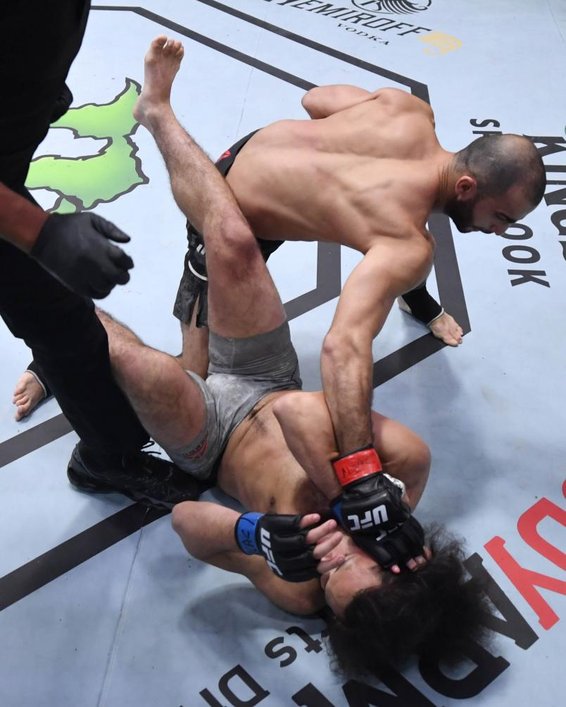 Giga Chikadze of Georgia punches Jamey Simmons in a featherweight fight during the UFC Fight Night event at UFC APEX on November 07, 2020 in Las Vegas, Nevada. (Photo by Jeff Bottari/Zuffa LLC)