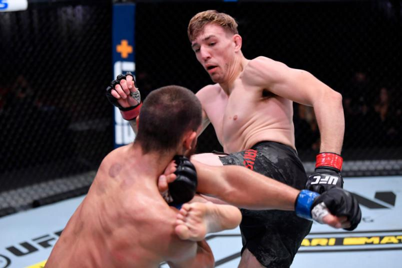 Kyle Daukaus kicks Dustin Stoltzfus in their middleweight bout during the UFC 255 event at UFC APEX on November 21, 2020 in Las Vegas, Nevada. (Photo by Jeff Bottari/Zuffa LLC)