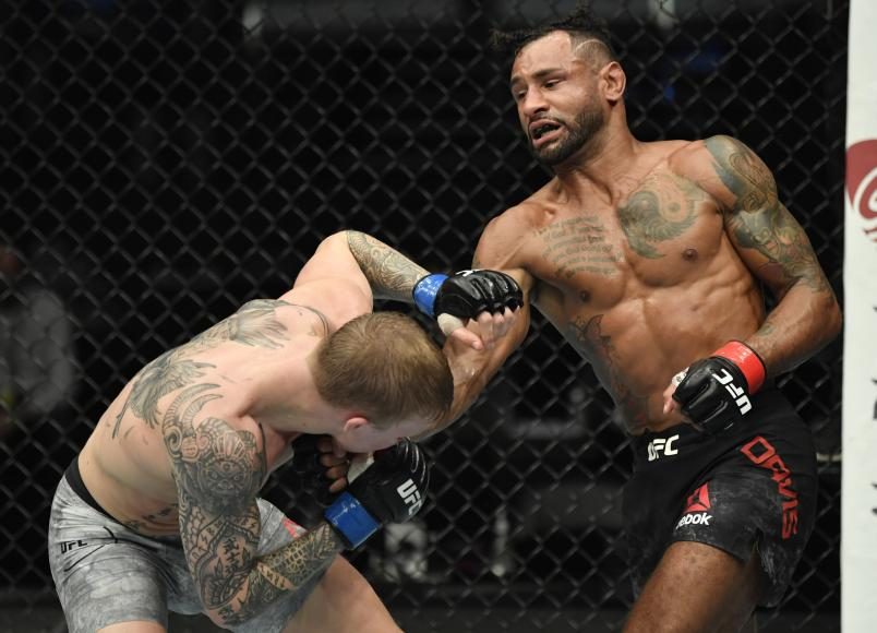 Mike Davis punches Mason Jones in a lightweight fight during the UFC Fight Night event at Etihad Arena on UFC Fight Island on January 20, 2021 in Abu Dhabi, United Arab Emirates. (Photo by Jeff Bottari/Zuffa LLC)