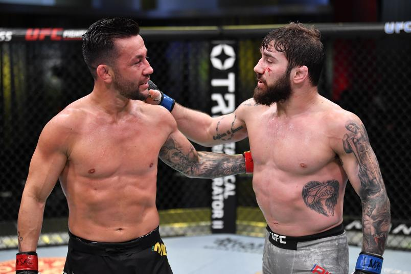 Pedro Munhoz of Brazil and Jimmie Rivera talk after their bantamweight bout during the UFC Fight Night event at UFC APEX on February 27, 2021 in Las Vegas, Nevada. (Photo by Jeff Bottari/Zuffa LLC)