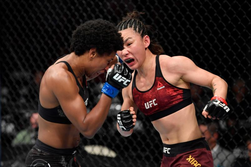 Yan Xiaonan of China punches Angela Hill in their women's strawweight bout during the UFC 238 event at the United Center on June 8, 2019 in Chicago, Illinois. (Photo by Jeff Bottari/Zuffa LLC/Zuffa LLC via Getty Images)