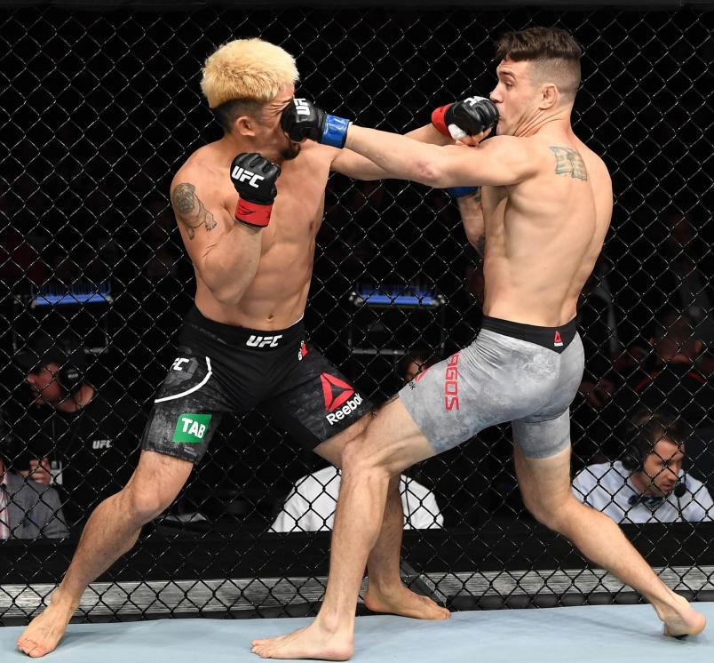 Christos Giagos punches Mizuto Hirota of Japan in their lightweight bout during the UFC Fight Night event inside Adelaide Entertainment Centre on December 2, 2018 in Adelaide, Australia. (Photo by Jeff Bottari/Zuffa LLC/Zuffa LLC via Getty Images)