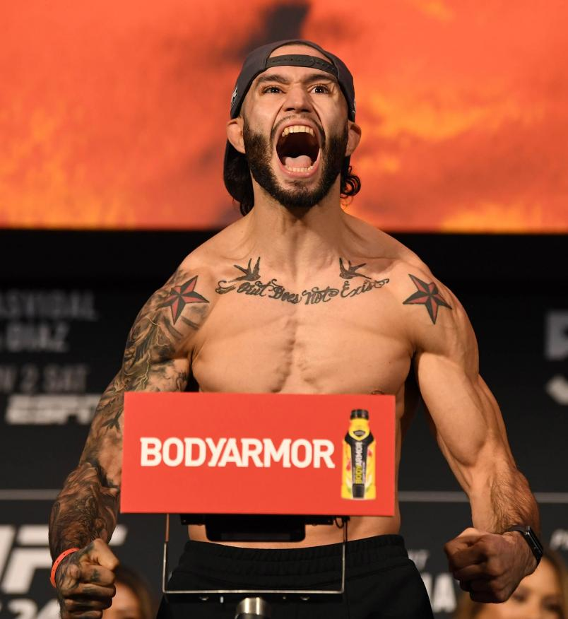 Shane Burgos poses on the scale during the UFC 244 weigh-ins at the Hulu Theatre at Madison Square Garden on November 1, 2019 in New York, New York. (Photo by Josh Hedges/Zuffa LLC)