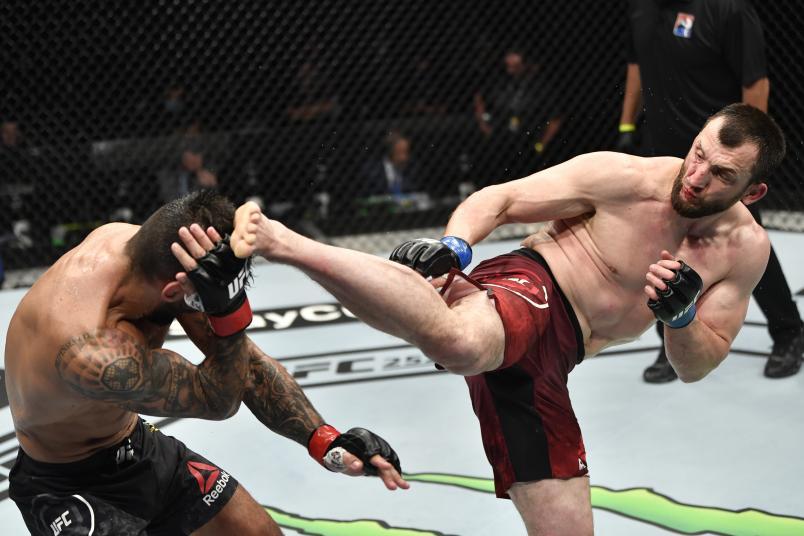 Muslim Salikhov kicks Elizeu Zaleski dos Santos in their welterweight fight during the UFC 251 event at Flash Forum on UFC Fight Island on July 12, 2020 on Yas Island, Abu Dhabi, United Arab Emirates. (Photo by Jeff Bottari/Zuffa LLC