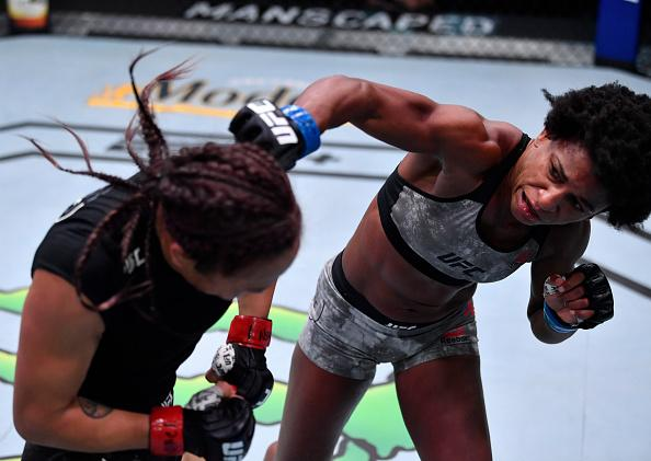 Angela Hill punches Michelle Waterson in a strawweight fight during the UFC Fight Night event at UFC APEX on September 12, 2020 in Las Vegas, Nevada. (Photo by Jeff Bottari/Zuffa LLC)