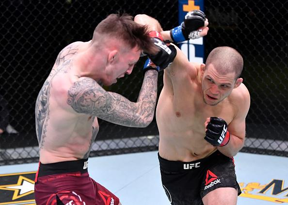 Alex Morono punches Rhys McKee of Northern Ireland in a welterweight fight during the UFC Fight Night event at UFC APEX on November 14, 2020 in Las Vegas, Nevada. (Photo by Jeff Bottari/Zuffa LLC)