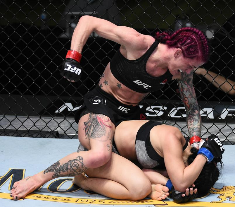 Gina Mazany punches Rachael Ostovich in their women's flyweight bout during the UFC Fight Night at UFC APEX on November 28, 2020 in Las Vegas, Nevada. (Photo by Chris Unger/Zuffa LLC)