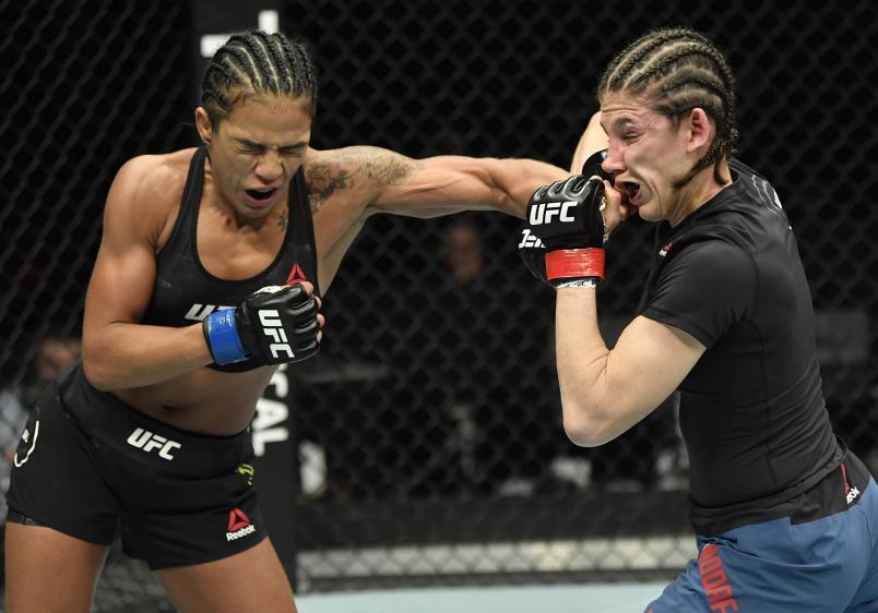 (L-R) Viviane Araujo of Brazil punches Roxanne Modafferi in a flyweight fight during the UFC Fight Night event at Etihad Arena on UFC Fight Island on January 20, 2021 in Abu Dhabi, United Arab Emirates. (Photo by Jeff Bottari/Zuffa LLC)