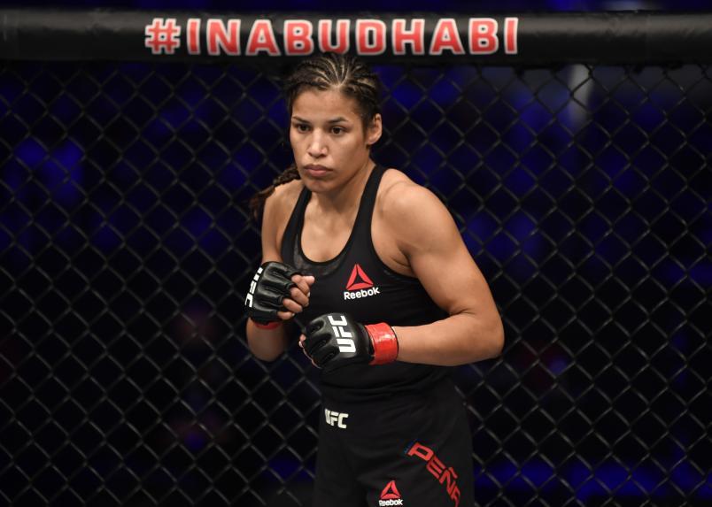 Julianna Pena battles Sara McMann in a bantamweight fight during the UFC 257 event inside Etihad Arena on UFC Fight Island on January 23, 2021 in Abu Dhabi, United Arab Emirates. (Photo by Jeff Bottari/Zuffa LLC)