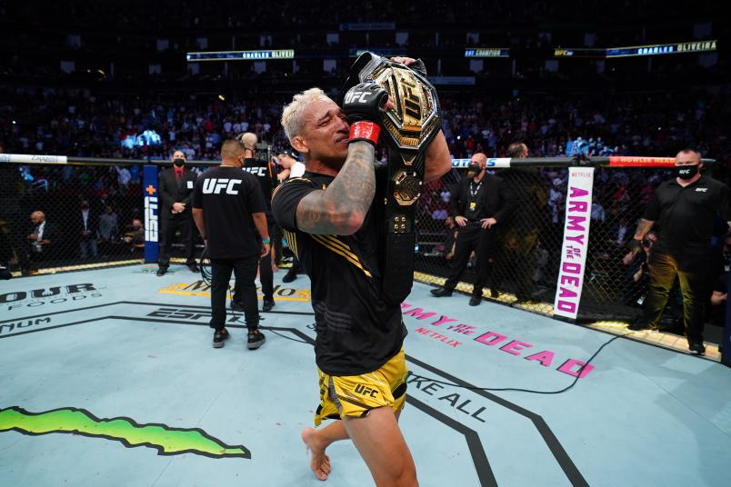 Charles Oliveira of Brazil reacts after defeating Michael Chandler in their UFC lightweight championship bout at Toyota Center on May 15, 2021 in Houston, Texas. (Photo by Josh Hedges/Zuffa LLC)