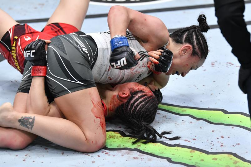 Carla Esparza punches Yan Xiaonan of China in their women's strawweight bout during the UFC Fight Night event at UFC APEX on May 22, 2021 in Las Vegas, Nevada. (Photo by Chris Unger/Zuffa LLC)