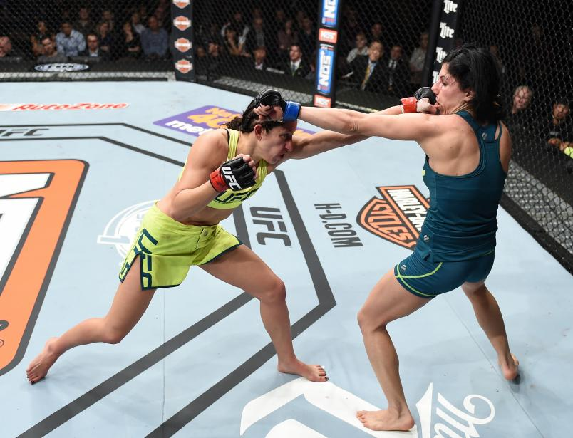 Jessica Penne exchanges punches with Randa Markos in their strawweight fight during The Ultimate Fighter Finale event inside the Pearl concert theater at the Palms Casino Resort on December 12, 2014 in Las Vegas, Nevada. (Photo by Jeff Bottari/Zuffa LLC)