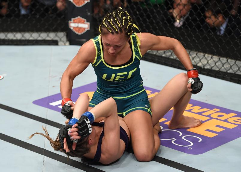 Carla Esparza punches Rose Namajunas in their strawweight championship fight during The Ultimate Fighter Finale event on December 12, 2014 in Las Vegas, Nevada. (Photo by Jeff Bottari/Zuffa LLC)