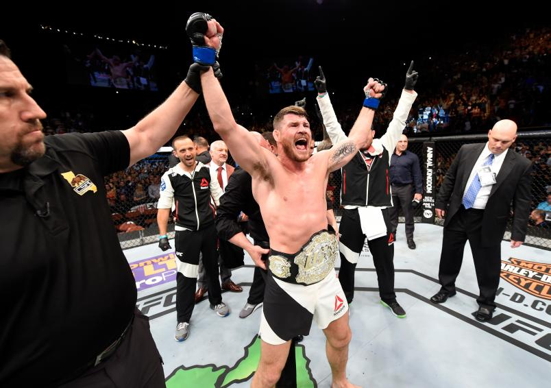 Michael Bisping of England celebrates after his first round knockout win against Luke Rockhold in their UFC middleweight championship bout during the UFC 199 event at The Forum on June 4, 2016 in Inglewood, California. (Photo by Josh Hedges/Zuffa LLC)