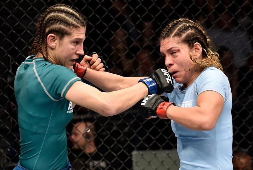 Roxanne Modafferi punches Nicco Montano in their women's flyweight championship bout during the TUF Finale event on December 01, 2017 in Las Vegas, Nevada. (Photo by Jeff Bottari/Zuffa LLC)