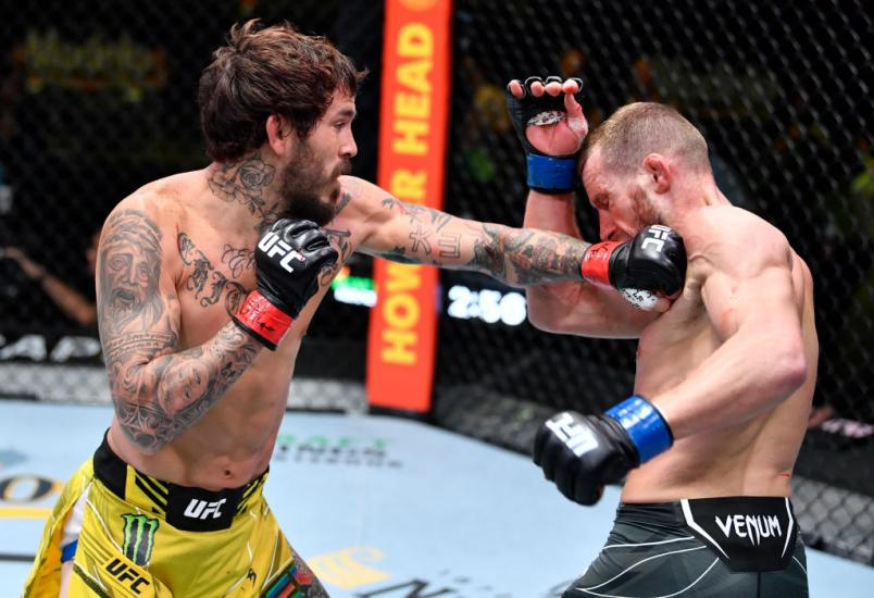 Marlon Vera of Ecuador punches Davey Grant of England in a bantamweight bout during the UFC Fight Night event at UFC APEX on June 19, 2021 in Las Vegas, Nevada. (Photo by Chris Unger/Zuffa LLC)
