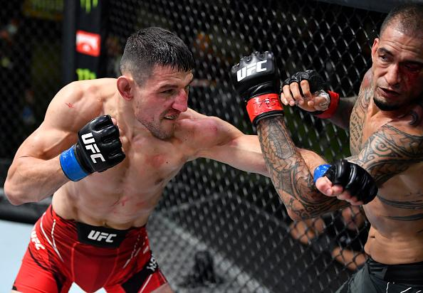 Damir Hadzovic of Bosnia punches Yancy Medeiros in a lightweight fight during the UFC Fight Night event at UFC APEX on June 26, 2021 in Las Vegas, Nevada. (Photo by Chris Unger/Zuffa LLC)