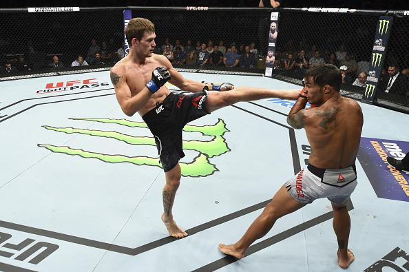 Rick Glenn kicks Dennis Bermudez in their featherweight fight during the UFC Fight Night event inside CenturyLink Arena on July 14, 2018 in Boise, Idaho. (Photo by Josh Hedges/Zuffa LLC)
