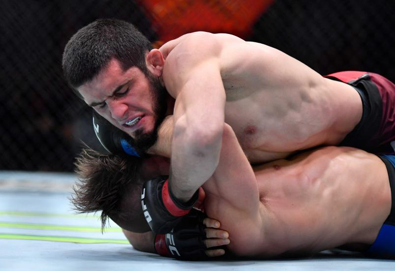 Islam Makhachev punches Drew Dober in their lightweight fight during the UFC 259 event at UFC APEX on March 06 2021 in Las Vegas Nevada (Photo by Chris Unger/Zuffa LLC)