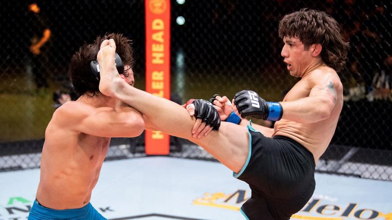 Daniel Argueta of Team Ortega kicks bantamweight Ricky Turcios during their fight on The Return of The Ultimate Fighter. (Photo by Chris Unger/Zuffa LLC)