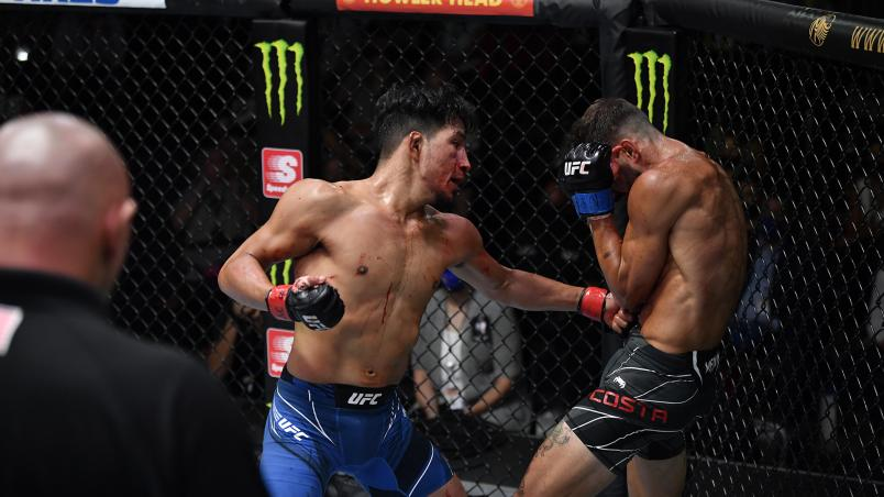 Adrian Yanez punches Randy Costa in their bantamweight fight during the UFC Fight Night event at UFC APEX on July 24, 2021 in Las Vegas, Nevada. (Photo by Jeff Bottari/Zuffa LLC)