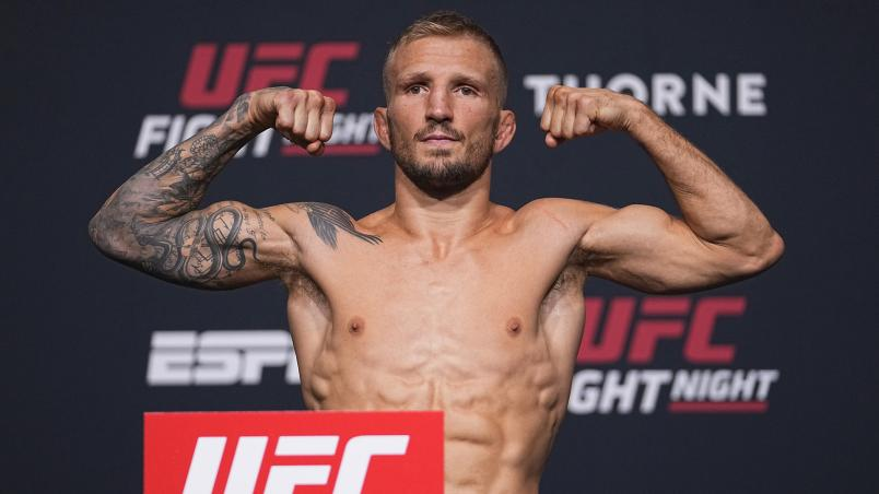 T.J. Dillashaw poses on the scale during the UFC Fight Night weigh-in at UFC APEX on July 23, 2021 in Las Vegas, Nevada. (Photo by Jeff Bottari/Zuffa LLC)