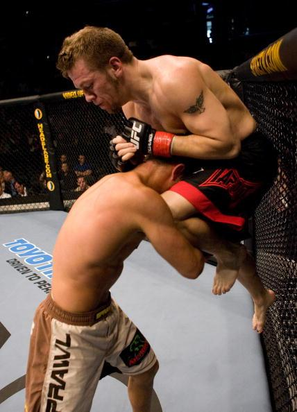 Spencer Fisher knees Matt Wiman at UFC 60 at Staples Center on May 27, 2006 in Los Angeles, California. (Photo by Josh Hedges/Zuffa LLC)