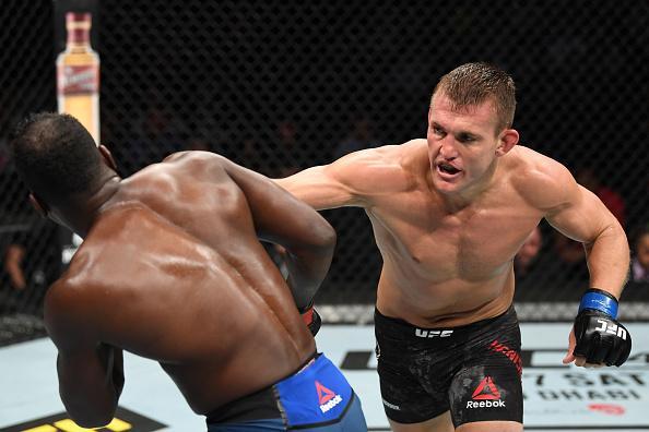 Ian Heinisch punches Derek Brunson in their middleweight bout during the UFC 241 event at the Honda Center on August 17, 2019 in Anaheim, California. (Photo by Josh Hedges/Zuffa LLC)