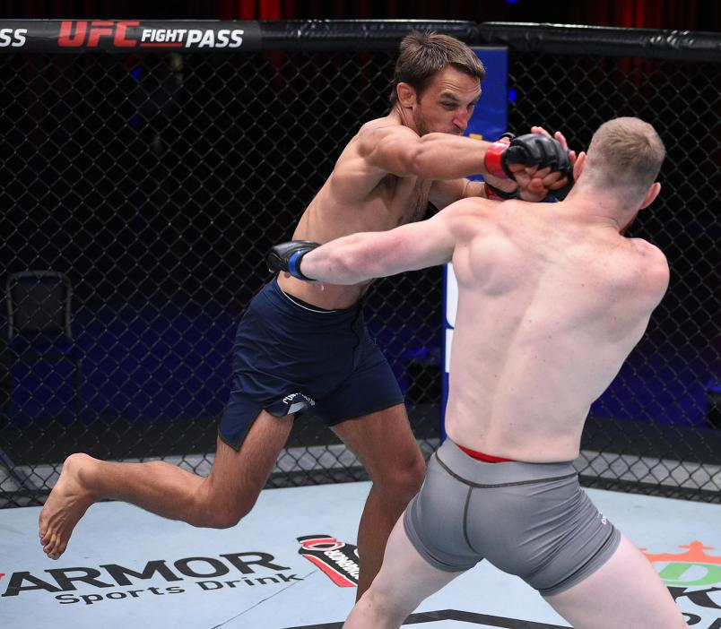 Dustin Stoltzfus punches Joe Pyfer in a middleweight fight during week two of Dana White's Contender Series season four at UFC APEX on August 11, 2020 in Las Vegas, Nevada. (Photo by Chris Unger/DWCS LLC/Zuffa LLC)