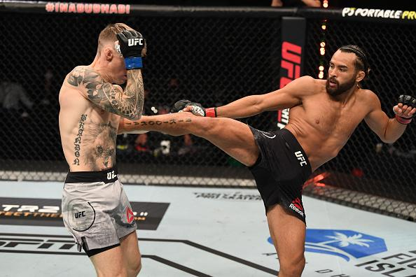 Kyler Phillips kicks Cameron Else of England in their bantamweight bout during the UFC Fight Night event inside Flash Forum on UFC Fight Island on October 04, 2020 in Abu Dhabi, United Arab Emirates. (Photo by Josh Hedges/Zuffa LLC)