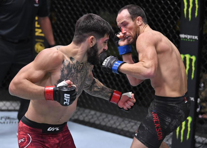Ilia Topuria of Germany punches Damon Jackson in a featherweight bout during the UFC Fight Night event at UFC APEX on December 05 2020 in Las Vegas Nevada. (Photo by Chris Unger/Zuffa LLC)