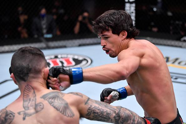 Billy Quarantillo punches Gavin Tucker of Canada in their featherweight bout during the UFC 256 event at UFC APEX on December 12, 2020 in Las Vegas, Nevada. (Photo by Jeff Bottari/Zuffa LLC)
