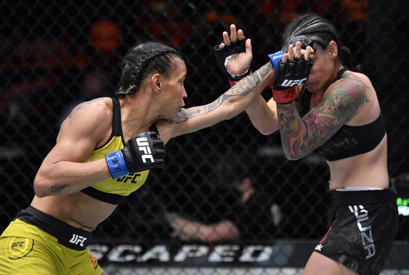 Amanda Lemos of Brazil punches Livinha Souza of Brazil in their strawweight fight during the UFC 259 event at UFC APEX on March 06, 2021 in Las Vegas, Nevada. (Photo by Jeff Bottari/Zuffa LLC)
