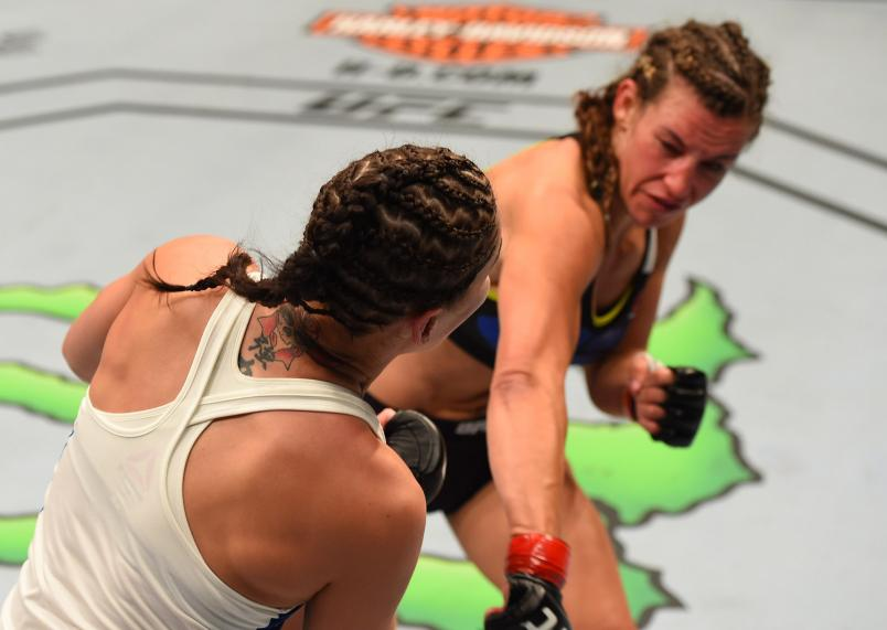 Miesha Tate drops Jessica Eye with a punch in their women's bantamweight bout during the UFC event at the United Center on July 25, 2015 in Chicago, Illinois. (Photo by Jeff Bottari/Zuffa LLC)
