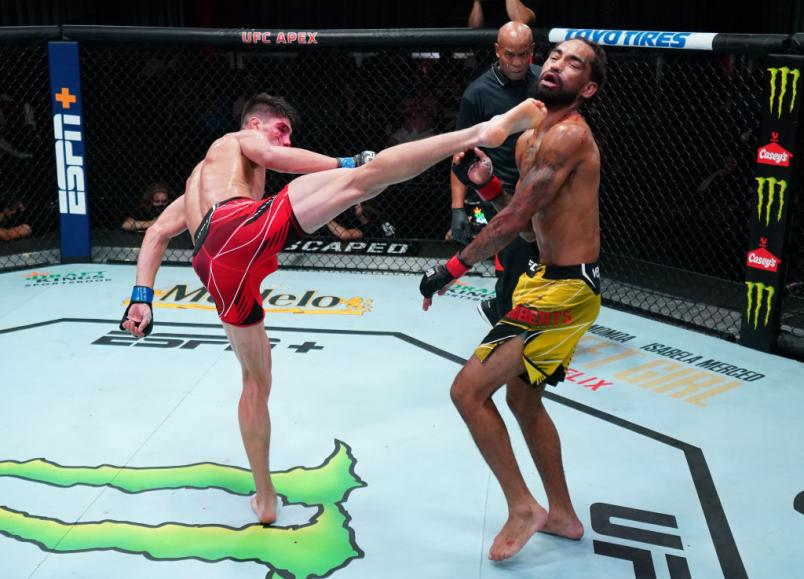 Ignacio Bahamondes of Chile knocks out Roosevelt Roberts with a kick in a lightweight fight during the UFC Fight Night event at UFC APEX on August 21, 2021 in Las Vegas, Nevada. (Photo by Chris Unger/Zuffa LLC)
