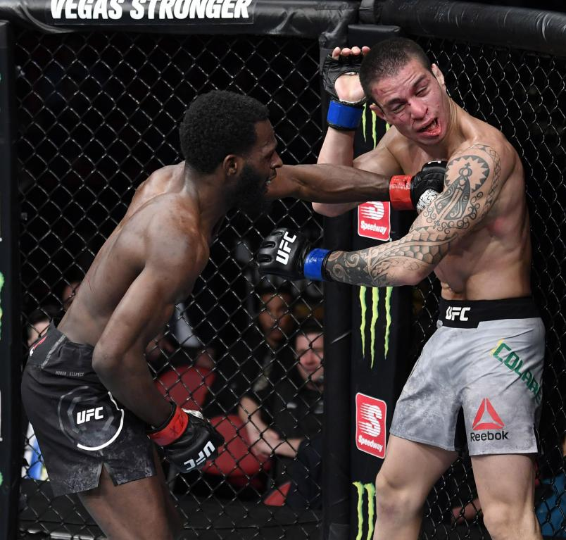 Montel Jackson punches Felipe Colares of Brazil in their bantamweight bout during the UFC Fight Night event at PNC Arena on January 25, 2020 in Raleigh, North Carolina. (Photo by Jeff Bottari/Zuffa LLC)