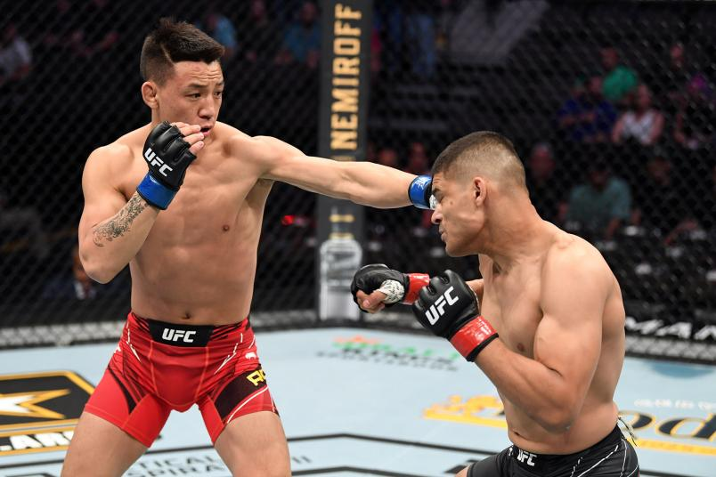 Rongzhu of China punches Kazula Vargas of Mexico in their lightweight bout during the UFC 261 event at VyStar Veterans Memorial Arena on April 24, 2021 in Jacksonville, Florida. (Photo by Josh Hedges/Zuffa LLC)