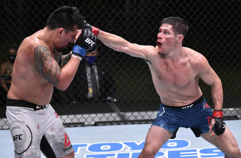 Charles Rosa punches Kevin Aguilar in their lightweight fight during the UFC Fight Night event at UFC APEX on June 13, 2020 in Las Vegas, Nevada. (Photo by Chris Unger/Zuffa LLC)