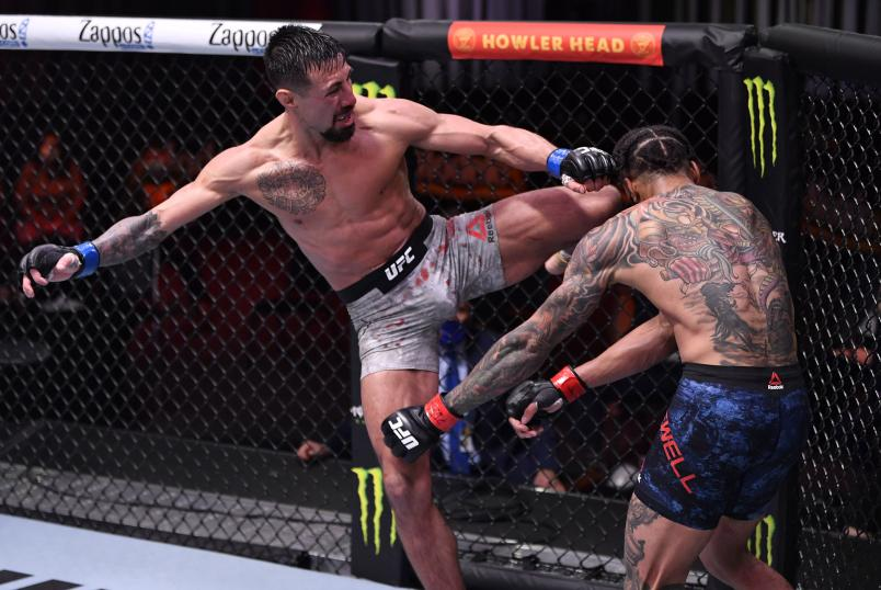 Chris Gutierrez kicks Andre Ewell in their 140-pound catchweight fight during the UFC 258 event at UFC APEX on February 13, 2021 in Las Vegas, Nevada. (Photo by Jeff Bottari/Zuffa LLC)