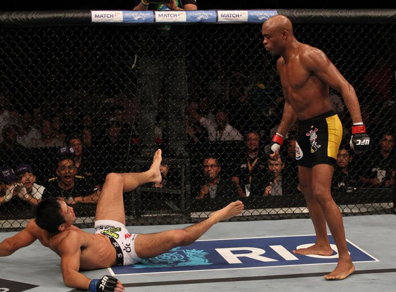 Anderson Silva moves in for the finish against Yushin Okami after knocking him down in the UFC Middleweight Championship bout at UFC 134 at HSBC Arena on August 27, 2011 in Rio de Janeiro, Brazil. (Photo by Al Bello/Zuffa LLC)