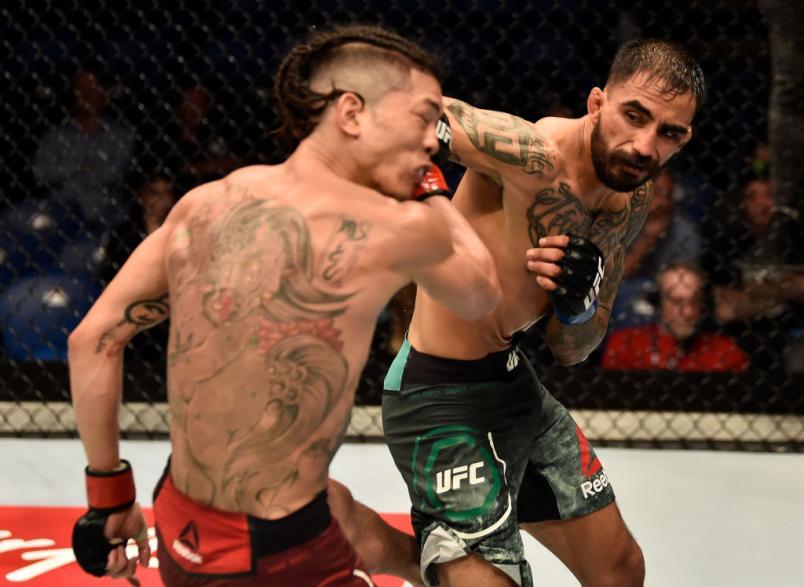 Jose Quinonez of Mexico punches Teruto Ishihara