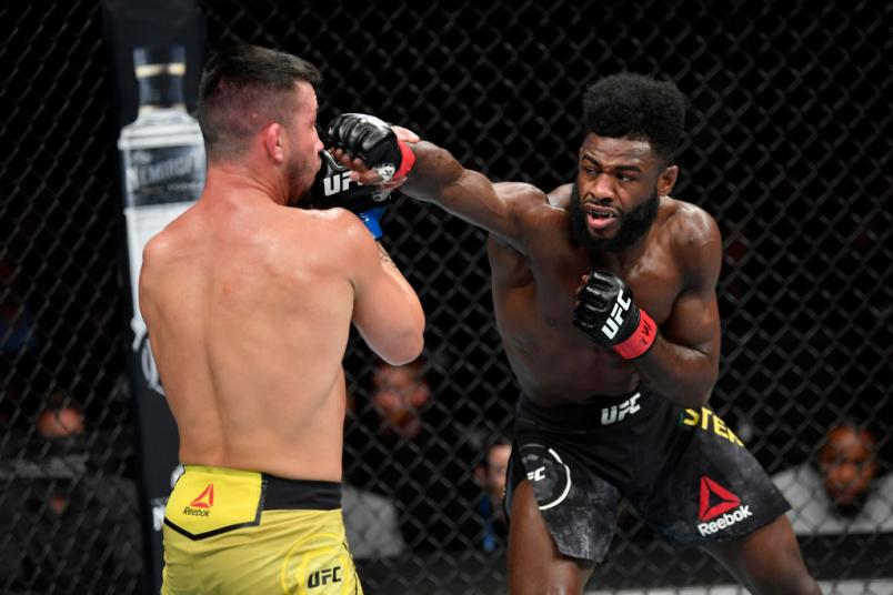 Aljamain Sterling punches Pedro Munhoz of Brazil in their bantamweight bout during the UFC 238
