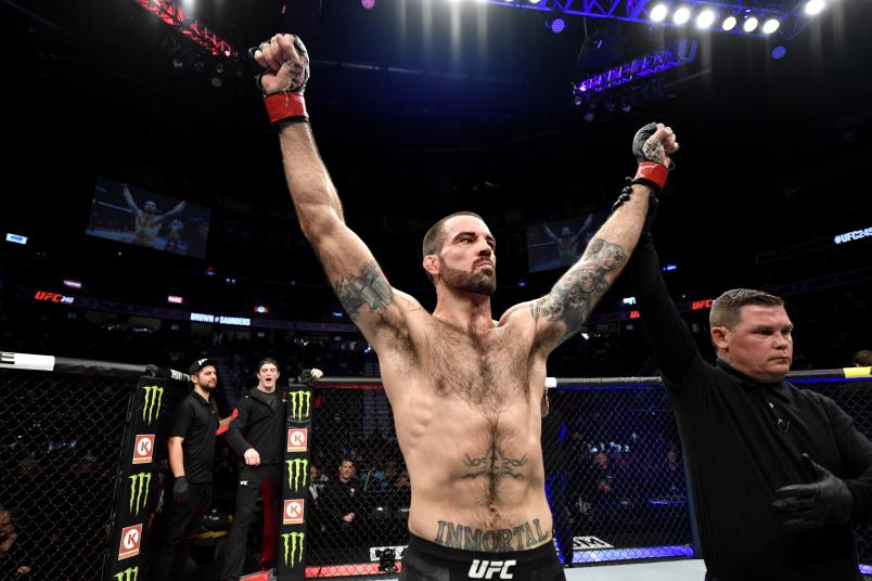 Matt Brown raises his hands in victory over Ben Saunders in their welterweight bout during the UFC 245.