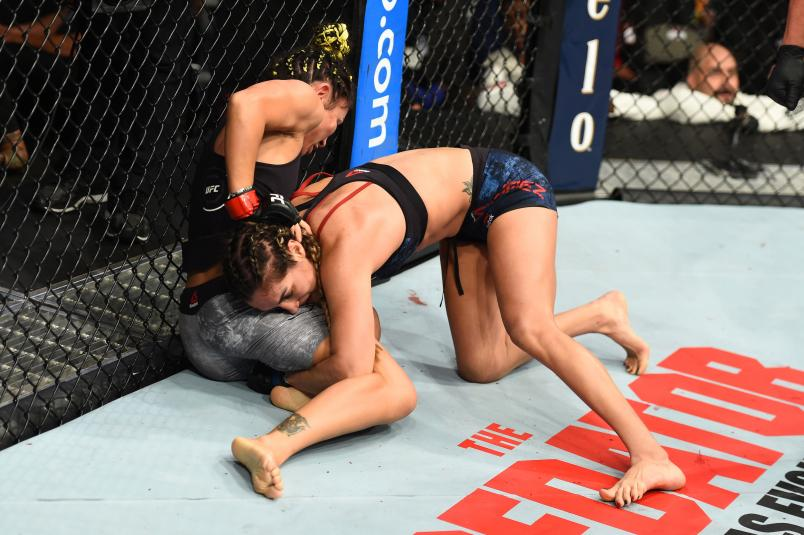 Tatiana Suarez takes down Carla Esparza in their women's strawweight fight during the UFC 228